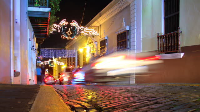 MS T/L People and traffic on cobble stone street / San Juan, Puerto Rico, United States