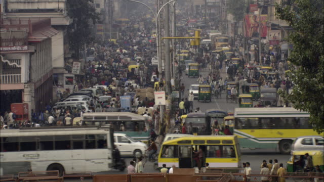 ha ws td people and traffic passing on busy street/ delhi, india - population explosion stock videos & royalty-free footage