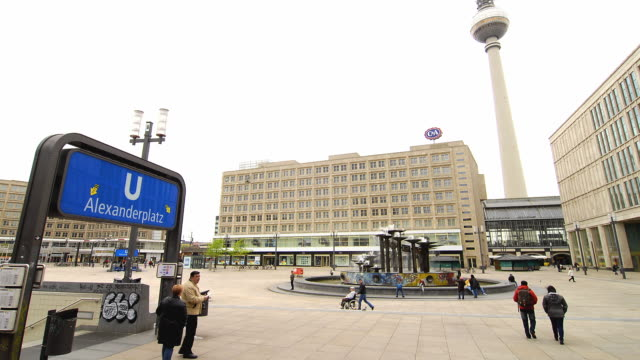 ws t/l people and trains passing through alexanderplatz / berlin, germany - alexanderplatz stock videos & royalty-free footage