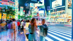 People and vehicles cross the famous Shibuya intersection in Tokyo in time-lapse