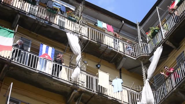 """people applaud and sing on their balconies during the flashmob during liberation day celebrations on april 25, 2020 in turin, italy. flashmob """"bella... - balcony stock videos & royalty-free footage"""