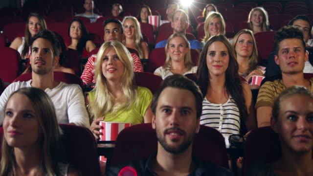 people applause in cinema - movie stock videos & royalty-free footage