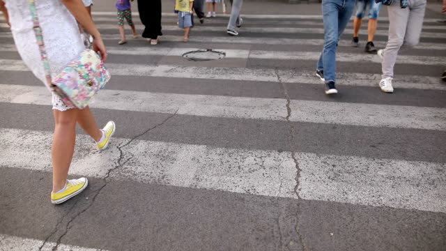 People are across the crosswalk