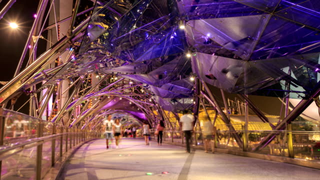 people are bridge singapore in night,time lapse. - helix bridge stock videos & royalty-free footage