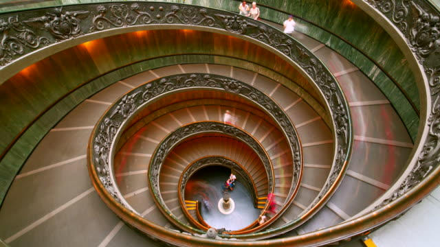 people are climbing up the spiral staircase in the vatican museum, italy - steps and staircases stock videos & royalty-free footage