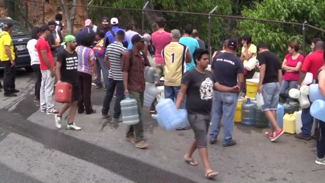 people are collecting water from tankers in venezuela as the country has been suffering from massive water shortages and power cuts for five days - crisis stock videos & royalty-free footage