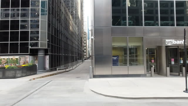people are coming out but some streets are still empty, especially during the weekend, positive cases are high these days in chicago amid the 2020... - side view stock videos & royalty-free footage