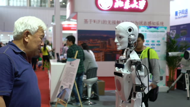people are communicating with robots on the 2nd world intelligence congress which was held in tianjin meijiang exhibition center from may 1618 2018 - the center stock videos and b-roll footage