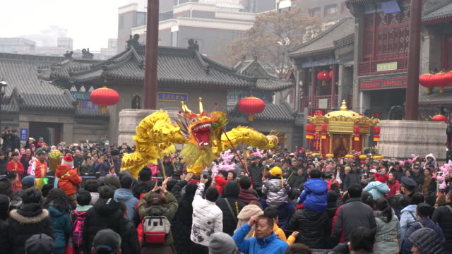 people are crowded to watch the dancing dragon performance dancing dragon lanterns is a traditional celebrating performance on temple fair - fifa world cup 2010 stock videos & royalty-free footage
