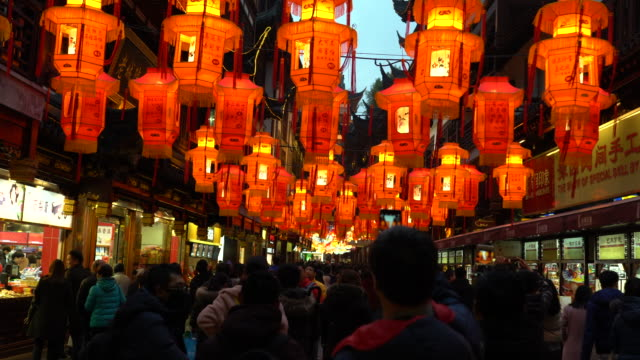 people are enjoying the lantern show at night 2018 shanghai yu garden lantern show the most famous and influential folk activity during spring... - lantern stock videos & royalty-free footage