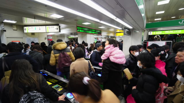 People are going through the automatic ticket gate at Hachiko Entrance Shibuya Station on Sunday evening.