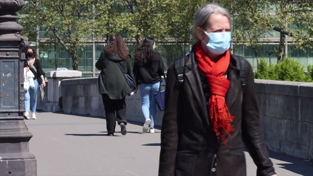 people are on the street in paris in the spring - france stock videos & royalty-free footage