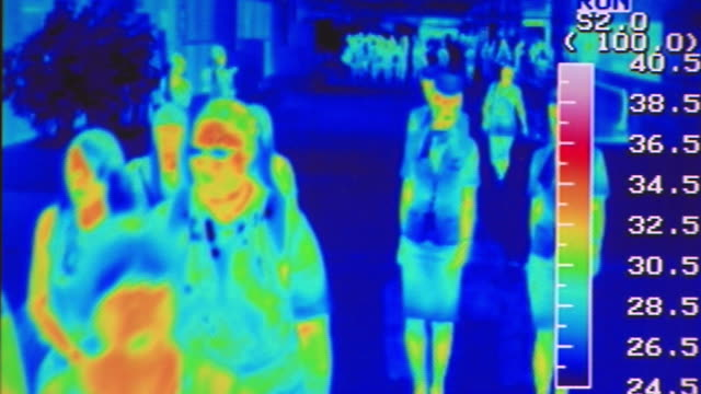 people are passing by thermo-graphic camera at incheon international airport - thermal imaging stock videos & royalty-free footage