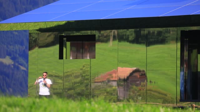 people are reflected in the mirrors of mirage gstaad by los angelesbased artist doug aitken is on display outside as installation sculpture... - kaleidoscope pattern stock videos & royalty-free footage