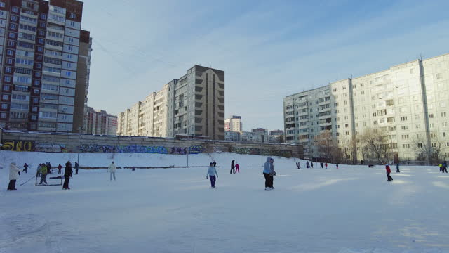 people are resting at the winter stadium while skating on ice. - russia stock videos & royalty-free footage