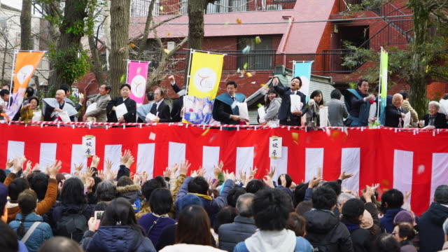 people are scattering soybeans to people for japanese traditional event setsubun (seasonal division) mamemaki (bean scattering) at kishibojin temple at zoshigay toshima ward tokyo japan on feb. 03 2019. - pagoda stock videos & royalty-free footage