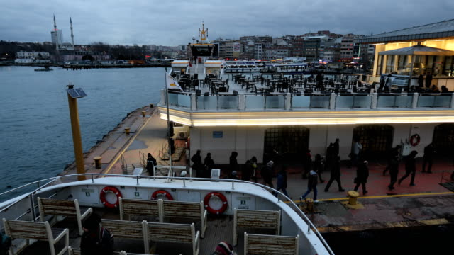 People are seen as they disembark a ferry at the Kadikoy ferry terminal on February 16 2016 in Istanbul Turkey