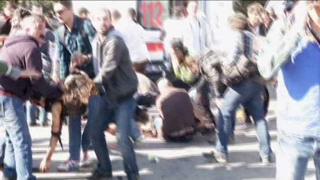 People are seen at the site of an explosion close to Ankara's main train station on October 10 2015 in Ankara Turkey A bomb exploded near Ankara's...