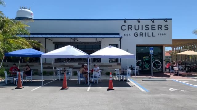 people are seen dining outside at cruisers grill as the state of florida enters phase one of the plan to reopen the state on may 04, 2020 in... - florida us state stock videos & royalty-free footage