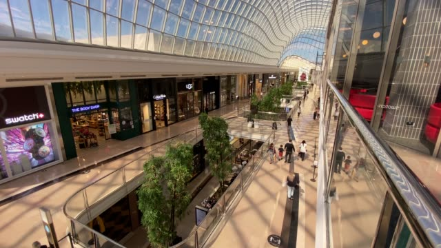 people are seen shopping at chadstone shopping centre on october 28, 2020 in melbourne, australia. lockdown restrictions in melbourne lifted as of... - tattoo stock videos & royalty-free footage