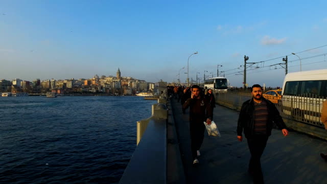 People are seen walking across the Galata Bridge on March 10 2017 in Istanbul Turkey Completed in 1994 the bridge spans the Golden Horn connecting...