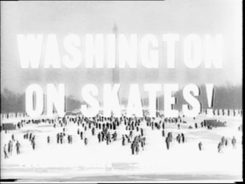 people are shown ice skating on the reflecting pool on the national mall washington dc with washington monument in background / girls putting on... - hampelmannsprung stock-videos und b-roll-filmmaterial