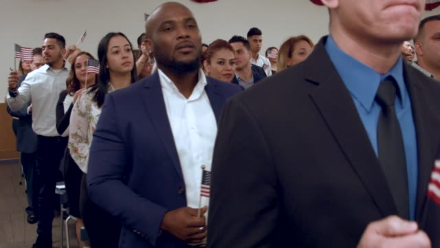 people are sworn in as american citizens during a us citizenship immigration services naturalization ceremony at the hialeah field office on january... - hialeah stock videos & royalty-free footage
