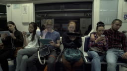People Are Using Tablets While Riding A Metro