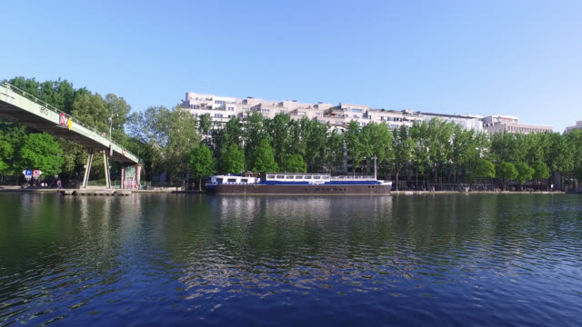 people are walking along the bassin de la villette canal april 22 2020 in paris france the country is issuing fines for people caught violating its... - pelvis stock videos & royalty-free footage