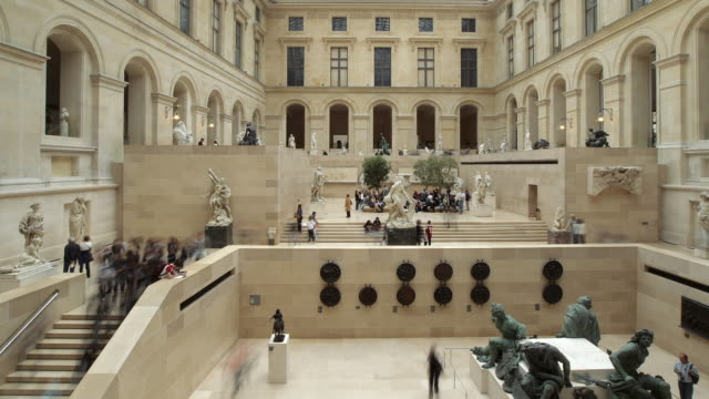 ws t/l people around statue in louvre museum / paris, france  - louvre stock videos and b-roll footage