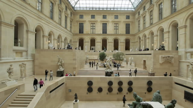 ws people around statue in louvre museum / paris, france  - louvre stock videos and b-roll footage