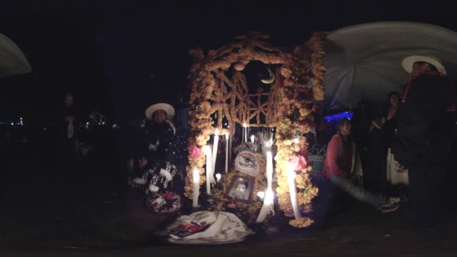 people around the altar at night, day of the dead in mexico - altar stock videos & royalty-free footage
