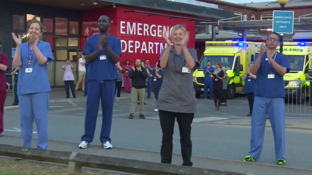people around the uk, in their streets, outside hospitals and nuns, clap for carers during the coronavirus lockdown - nun stock videos & royalty-free footage