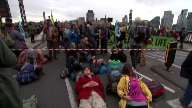 people arrested as extinction rebellion protesters set up camp in westminster; england: london: ext various of drummers taking part in extinction... - papier stock videos & royalty-free footage
