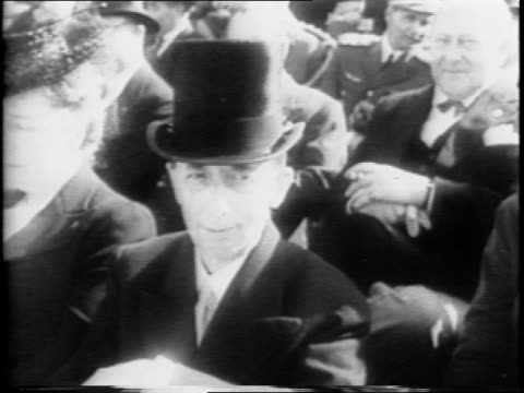 people arrive at stadium / chilean flag flies / president juan antonio rios arrives by carriage / crowd in stadium / chilean military cadets march... - anno 1942 video stock e b–roll