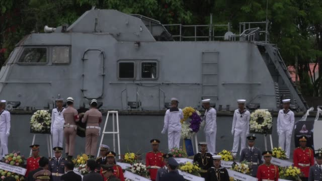 people arrive at the 10 years after the tsunami memorial services are held at the police boat 813 tsunami memorial in khao lak thailand - police boat stock videos and b-roll footage