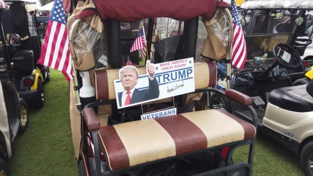 people arrive on golf carts to listen as u.s. president donald trump speaks during his campaign event at the villages polo club on october 23, 2020... - val evenemang bildbanksvideor och videomaterial från bakom kulisserna