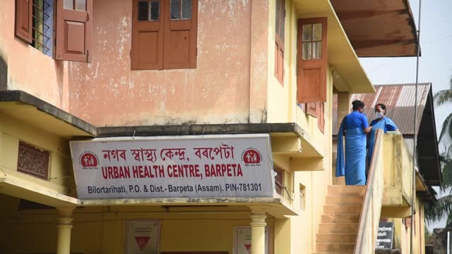 people arrives at a government healthcare centre to receive a covid-19 vaccine shot on march 6, 2021 in barpeta, india. india has entered the second... - building exterior stock videos & royalty-free footage