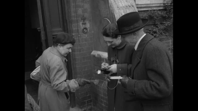 stockvideo's en b-roll-footage met people arriving and leaving polling station at richmond institute school in the 1955 general election - 1955
