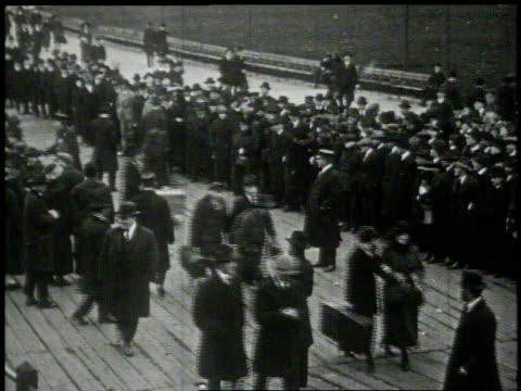 ms people arriving and waiting for new arrivals on a dock / new york new york united states - 1913 stock-videos und b-roll-filmmaterial