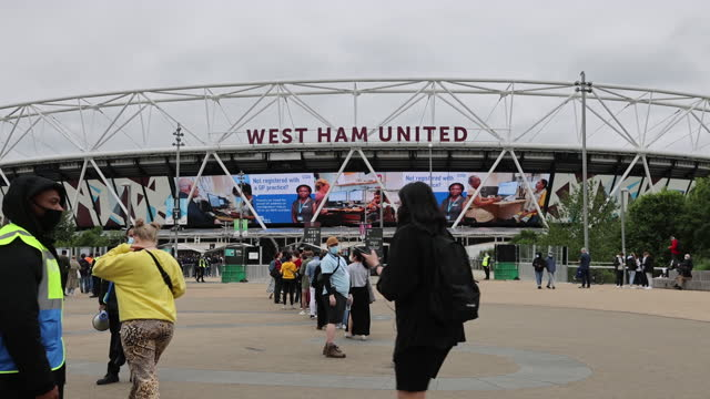 people arriving at london stadium for mass vaccination event, in london, u.k. on saturday, june 19, 2021. - new normal concept stock videos & royalty-free footage