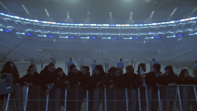 ws people arriving at o2 arena and running towards the crowd barrier / london, london, uk - the o2 england stock videos & royalty-free footage