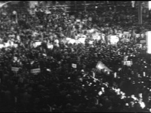 vídeos de stock e filmes b-roll de people arriving at sam houston hall, convention hall floor, al smith poster, vs franklin d. roosevelt speaking at podium , al smith poster in crowd,... - 1928