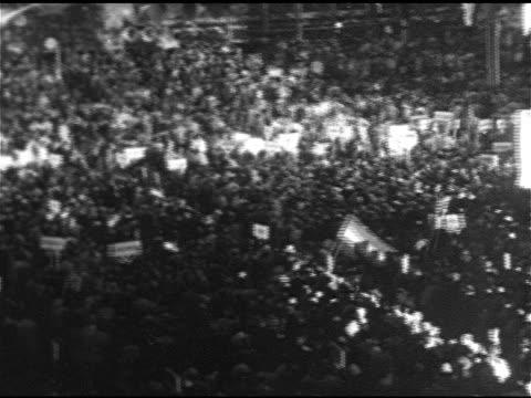 stockvideo's en b-roll-footage met people arriving at sam houston hall ha ws pan convention hall floor ws al smith poster ha vs franklin d roosevelt speaking at podium al smith poster... - al smith