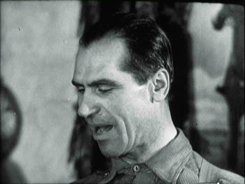 vídeos y material grabado en eventos de stock de people arriving at stakhonov's house / stakhonov being interviewed by press / people opening stakhonov's gifts - 1935