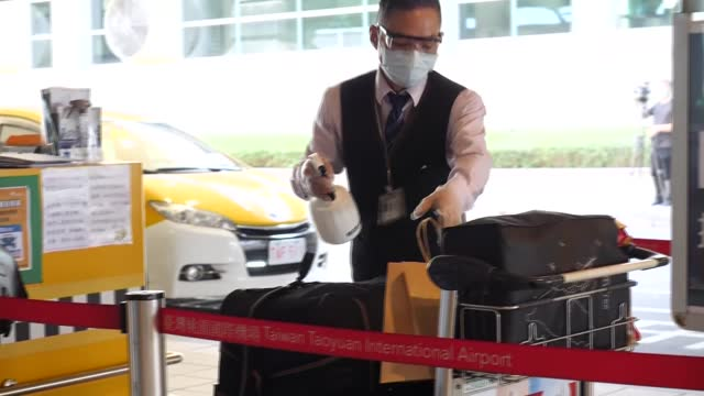 people arriving in taipei during the height of the coronavirus pandemic are disinfected before leaving airport - taipei stock videos & royalty-free footage