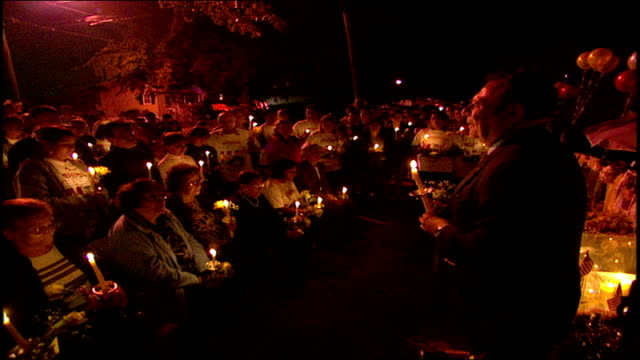 people at 9/11 candlelight vigil in front of house at night in paterson nj - 2001 stock videos & royalty-free footage