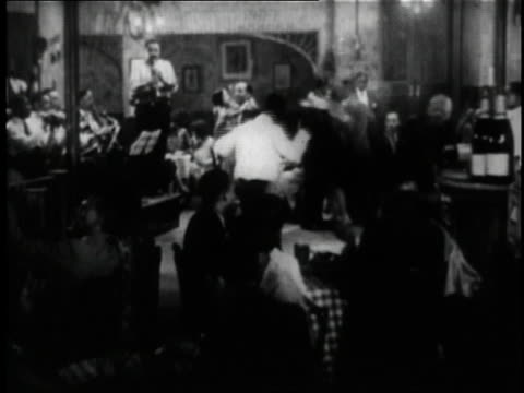 1929 montage people at a club dancing to a band in the short film st. louis blues / new york city, new york, united states - アメリカ黒人の歴史点の映像素材/bロール