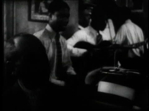 1929 montage people at a club singing along with bessie smith in the short film st. louis blues / new york city, new york, united states - 1920 1929 stock videos & royalty-free footage