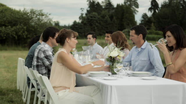 People at a dinner party on a farm